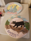 Jennifer Salman has been painting unglazed plates which are yet to be fired in a kiln,
